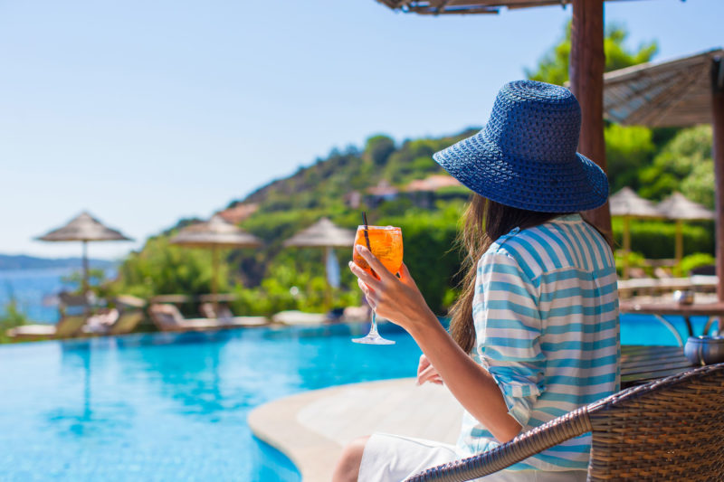 Summers Insurance view person at pool personal travel