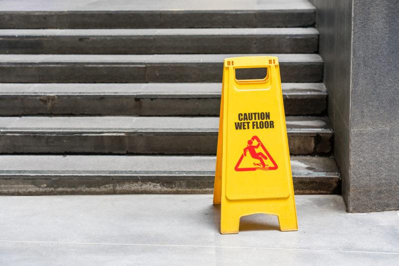 Summers Insurance Lobby floor hazard sign