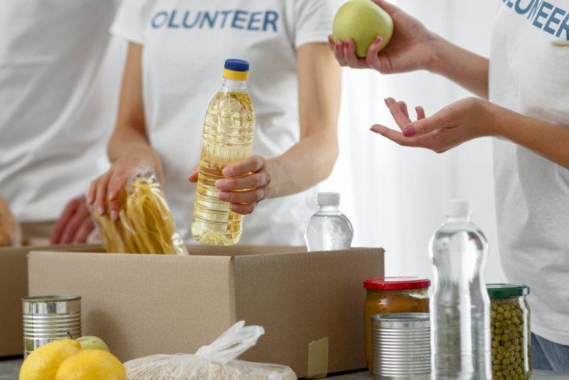 Volunteers preparing a donation box